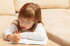 Little girl writing in her notebook Royalty Free Stock Image