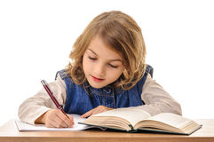 Little girl writing homework Royalty Free Stock Photo