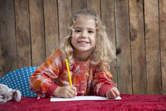 Little girl writing a letter Stock Images