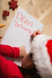 Little girl writing letter to santa at christmas Royalty Free Stock Photo