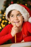 Little girl writing letter to santa at christmas Stock Images