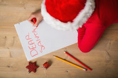 Little girl writing letter to santa at christmas Stock Photography