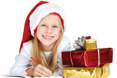 Little girl writing a letter to Santa Claus Stock Photos