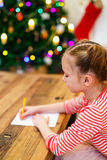 Little girl writing mail to Santa Stock Photo