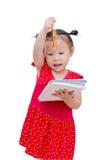 Little girl writing on notebook over white Stock Photo