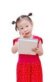 Little girl writing on notebook over white Stock Image