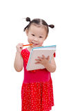 Little girl writing on notebook over white Royalty Free Stock Photography