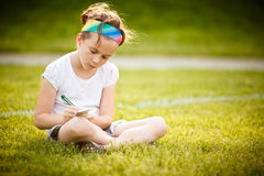 Little girl writing Royalty Free Stock Photos