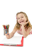 Little girl writing with pencils Royalty Free Stock Photos