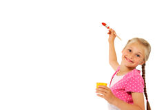 Little girl writing at the whiteboard Stock Image