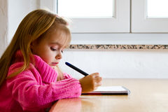 A little girl writing2 Royalty Free Stock Photo