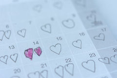 Little girl written heart thumbtack in date of February 14 Valentine. Little girl written heart thumbtack in date of February 14 Valentine Royalty Free Stock Images