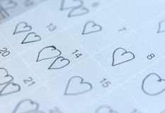 Little girl written heart thumbtack in date of February 14 Valentine. Little girl written heart thumbtack in date of February 14 Valentine Royalty Free Stock Photo