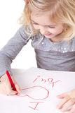 Little girl writting I love you Royalty Free Stock Photos