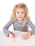 Little girl writting I love you mom Stock Images