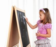 Little girl wrote in chalk Royalty Free Stock Photo