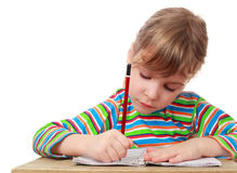 Little girl wrote, pencil in hand stock images