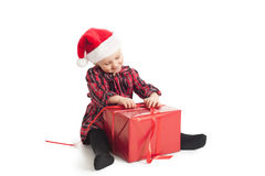 Little girl with xmas gift Stock Images