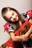 Little girl and xmas presents royalty free stock photography