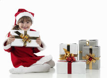 A little girl and xmas presents Stock Images