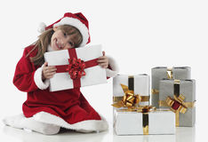 A little girl and xmas presents Stock Photography