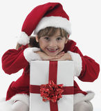 A little girl and xmas presents Stock Photos