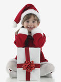 A little girl and xmas presents Royalty Free Stock Image