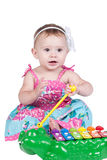Little girl with xylophone. Little girl sitting playing with a xylophone Stock Photo