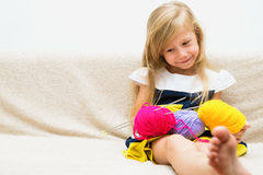 Little girl with yarn Stock Images