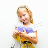 Little girl with yarn Stock Photo