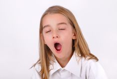 Little girl yawning Stock Image