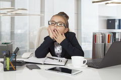 Little girl is yawning Stock Photos