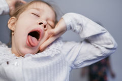 Little girl yawns and sleepy stock photos