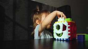 Little girl plays in the sorter stock footage