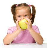Little girl with yellow apple Stock Photography