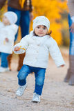 Little girl in yellow autumn park. Stock Image