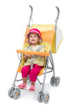 Little girl in a yellow baby carriage Royalty Free Stock Photography