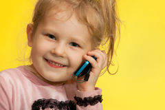 Little girl on the yellow background Royalty Free Stock Photos