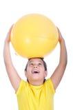 Little girl with yellow ball Stock Photo