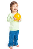 Little girl with yellow ball Royalty Free Stock Images