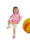Little girl and yellow ball Stock Photo