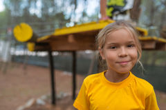 Little girl in yellow blouse on the playground Royalty Free Stock Photography