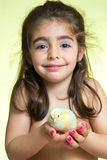 Little girl and yellow chick Royalty Free Stock Images