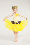 Little girl in yellow Royalty Free Stock Image