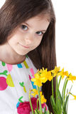 Little girl with yellow daffodils over white Stock Images