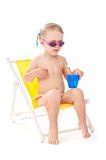 Little girl on yellow deckchair Royalty Free Stock Photo