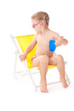 Little girl on yellow deckchair Stock Photos