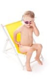 Little girl on yellow deckchair Royalty Free Stock Images
