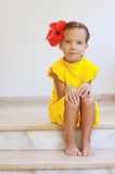 Little girl in yellow dress Royalty Free Stock Photos