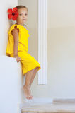 Little girl in yellow dress Stock Photo